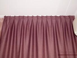 Складки, формируемые шторной лентой на портьере в закрытом состоянии.