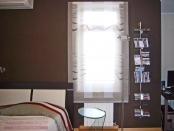 Фото-36. Римская штора на окне справа от кровати в комнате мальчика подростка.